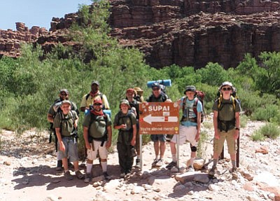The Scouts reach the Supia sign, from left: Tod Skinner, Skylar Rullman, Howard Jackson, Brandon Smith, Raven Christiansen, Caleb Burlington, Gary Smith, Payce Mortenson and Cooper Heap. Submitted photo