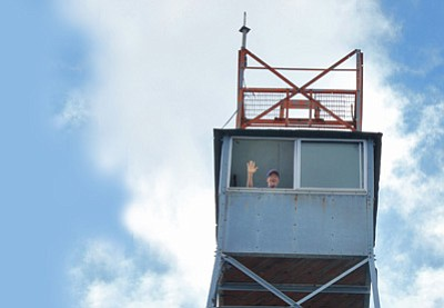 Jeff Newton waves from inside the bird's nest atop the Bill Williams fire tower. Wendy Howell/WGCN