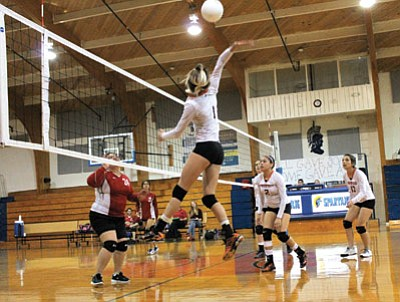 Lady Vike Dara Bowden goes for a kill against the Grand Canyon Lady Phantoms in the Ash Fork tournament Sept. 11. Loretta Yerianl/WGCN