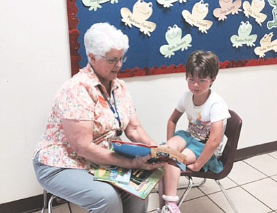 Volunteer Barb Parenteau reads with a Williams Elementary-Middle School student. Photo/Maya Caldwell