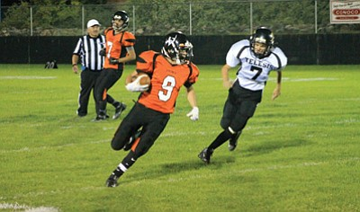 Viking running back Luis Cardenas works his way through the line during the Telesis Prep game. Wendy Howell/WGCN