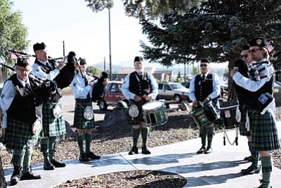 Southwest Skye Pipe and Drums put on a remembrance event on Sept. 11 at the Williams Veterans Memorial to honor first responders who gave their lives in the Twin Towers tragedy in New York City. Loretta Yerian/WGCN