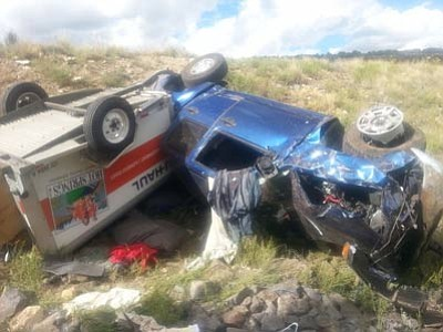 A truck and U-Haul trailer lie 30-feet off the road near I-40. The Williams Volunteer Fire Department responded to the roll-over crash on Ash Fork Hill Sept 14. One patient was transported to Flagstaff Medical Center and was in stable condition. Photo/Williams Volunteer Fire Department