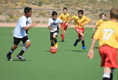 Heritage and Maine School players fight it out during a game Sept. 12 at Koch Field in Flagstaff.