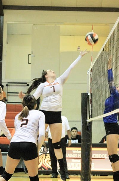Kami Batterton tips the ball over the net against Chino Valley Sept. 24. Wendy Howell/WGCN