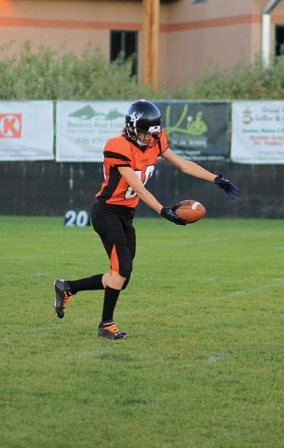 Vikings player Kenne Hoag kicks to the Mustangs. Wendy Howell/WGCN