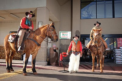 The Cataract Creek Gang rings the bell for the Williams Salvation Army in front of Safeway during the 2014 holiday season.  Ryan Williams/WGCN