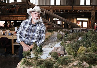 Jim Garvey stands next to a portion of his model of the Grand Canyon Railway and the Grand Canyon. Ryan Williams/WGCN