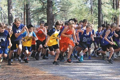 Williams and Maine Consolidated School fifth and sixth graders take off at the start of the Parks Cross-country Invitational Oct. 7. Wendy Howell/WGCN