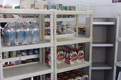 Shelves sit empty at the Food Bank. Volunteers are hoping to fill them with holiday food donations. Wendy Howell/WGCN