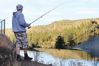 Alex Howell takes advantage of the high water level and the good fishing at Buckskinner Lake. City managers are hoping the Sweetwater Well will reduce the amount of water needed from the lakes for the city's water supply. Wendy Howell/WGCN