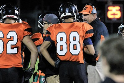 Coach Jeff Brownlee discusses a play with Viking Zack Perkins during a 2015-2016 game. Brownlee was selected as the Sectional Coach of the Year Dec. 5 by his fellow coaches. Wendy Howell/WGCN