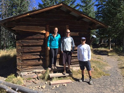 NAU students Brooke Anderson, Noah Mills and Jake Washburn inspect the Kendrick Lookout Cabin in October 2015. The students worked with Kaibab National Forest employees to develop proposed options for restoring and preserving the cabin. Photo Kaibab National Forest
