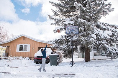 Damien Pacheco tries to get some basketball practice in Friday following a week of snowstorms. Ryan Williams/WGCN