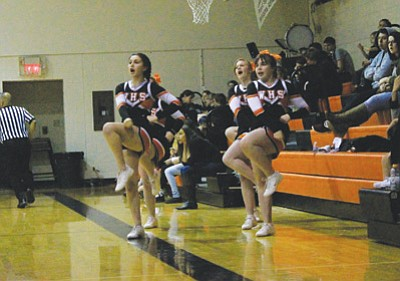 Williams High School cheerleaders motivate the crowd during a recent Vikings basketball game. Wendy Howell/WGCN