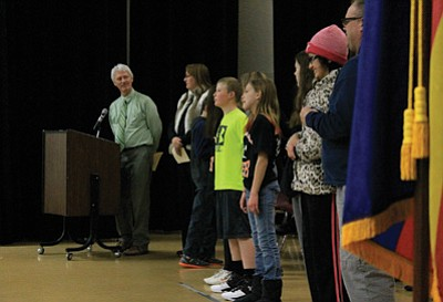 Science teacher Clint Keller presents academic awards to middle school students. Wendy Howell/WGCN