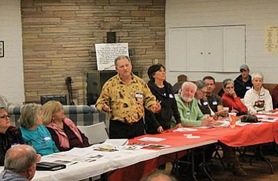 Community radio owner Leslie Stevens addresses people attending the Jan. 14 Event Huddle. Wendy Howell/WGCN