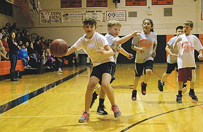 Shaelee and JP Echeverria battle for a loose ball during the Williams Youth basketball game Jan. 15. Wendy Howell/WGCN