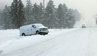 A van rests off the slick roadway on Route 66. Wendy Howell/WGCN