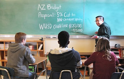 Williams High School math teacher Jet Feliciano explains school district budget challenges to his students. (March 2015 file photo by Ryan Williams/WGCN)