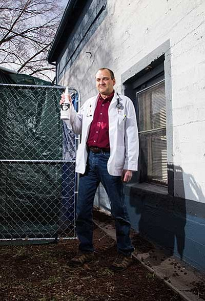 The Williams Veterinary Clinic's Dr. Daniel Jacoby stands prepared with Skunk Off in the alley next to his clinic.Ryan Williams/WGCN