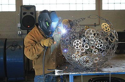 Ash Fork High School student Kyle Howard works on a project in the welding shop at Ash Fork High School. The school has a strong technical education program along with college prep classes. Wendy Howell/WGCN
