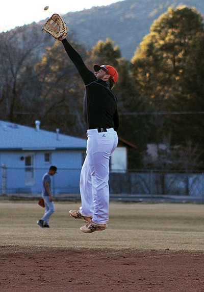Ethan Johnson lunges for a pop-up at first base. Wendy Howell/WGCN