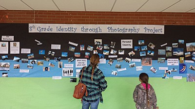 Visitors observe the eighth grade Photo Identity project at Williams Elementary Middle School. submitted photo