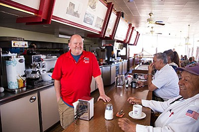 Jeff Pruett, chef and owner of Jeff's Place at Goldie's, stands in the dining room of his classic diner on Route 66. Ryan Williams/WGCN