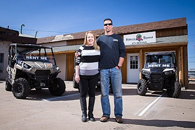 Doug and Lisa Maurer stand with their OHV fleet at Forest Trails ATV Rentals in Williams. Ryan Williams/WGCN