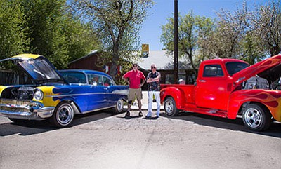 American Legion Cordova Post No. 13 members John Holst and Rodger Ely stand in front of the Legion Post between two classic cars. Ryan Williams/WGCN