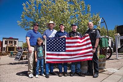John Moede, Kyle Pearson, John Moore, Chase Pearson, Arizona Nation of Patriots coordinator Dan Smith, Arizona Nation of Patriots Vice-Chairman Rick Bitzer hold an American flag. Ryan Williams/WGCN