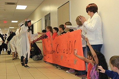 The students congratulate the class of 2016 as the graduates walk through the hallways during the annual Grad March. Wendy Howell/WGCN
