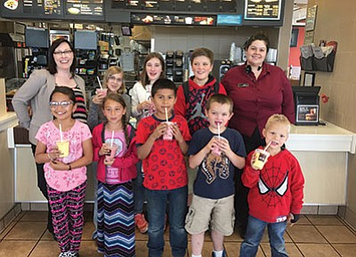 May Students of the Month pose with their treats donated by McDonalds. Clockwise from top left: Principal Carissa Morrison, Corinna Jorgensen, Shae Simpson, Oryn Orozco, McDonalds Manager Theresa Lacy, Stiles Christiansen, Michael Merimon, Brayan Ortiz, Reina Rocha and Leslie Urias. Submitted photo