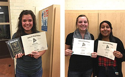 Carli Grantham accepts her varsity award. Jamie Donovan and Paola Belmontes display their junior varsity awards. Photos by Cindy Sutton