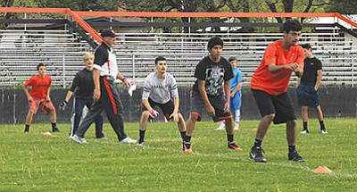 Vikings football players work through drills during the football camp May 18. Wendy Howell/WGCN