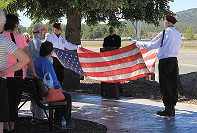 Veterans Rodger Ely and Al Dunaway fold the flag. Wendy Howell/WGCN