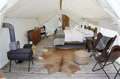 Tents have a variety of amenities such as king size beds, wood stoves, dressers and hot water. Submitted photo