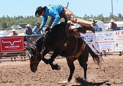 A bronc rider tests his skills during the Cowpunchers Reunion rodeo June 17. Ryan Williams/WGCN