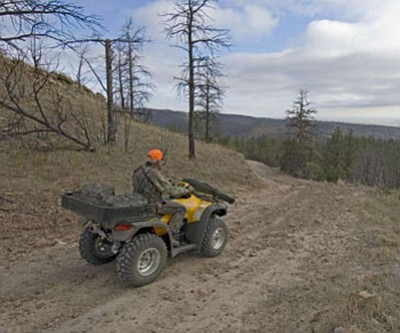A hunter uses his ATV on forest service land in Arizona. Photo/USFS