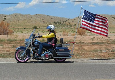 A Nation of Patriots participate displays the U.S. Flag during the 2015 armed forces support tour. Photo/Nation of Patriots Tour