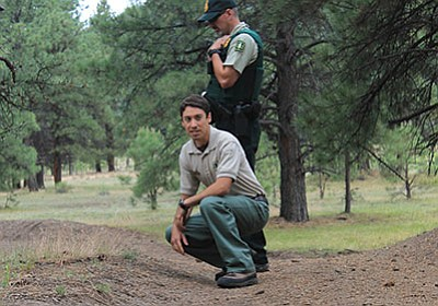 Kaibab NEPA Coordinator Marcos Roybal and Kaibab Law Enforcement Officer Jerry Parker evaluate resource damage from off-road vehicle use on the Williams District of Kaibab National Forest. Wendy Howell/WGCN
