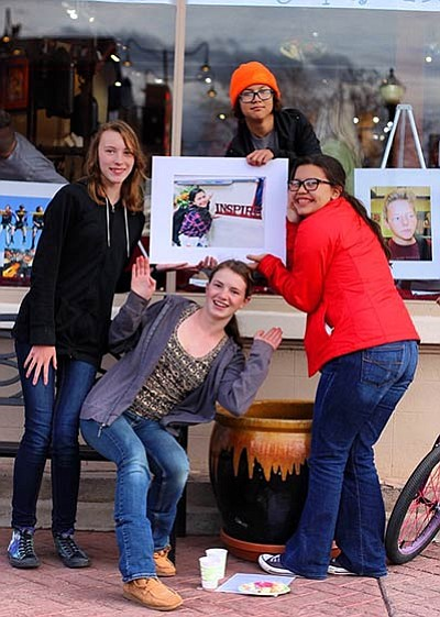 WEMS eighth grade students enjoy an art reception to celebrate the Identity Through Photography project sponsored by Williams Alliance for the Arts. photo/Amy Martin