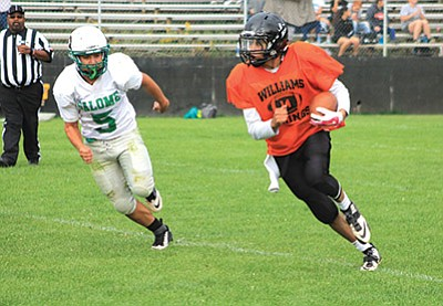 Vikings quarterback Martin Soria beats a defender and takes the ball for some yardage during the scrimmage against Salome Aug. 20. Wendy Howell