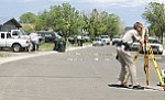 An Arizona Department of Public Safety officer assists the Williams Police Drpartment with the investigation of a fatal accident involving a Williams High School student on graduation day, May 27.