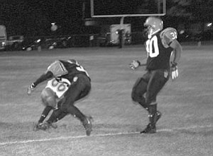 Vikings running back/line backer Tyrell Valdivia, No. 30, rushes in to assist in the take-down of a Red Mesa runner by another Vikings player at the Oct. 14 home game.