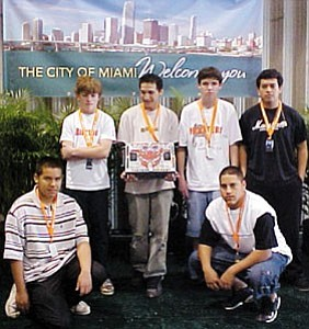 The Slab Crabs pause for a moment in Miami. Pictured clockwise from left is Juan Hernandez, Andrew Eastland, Aaron Buchmoyer, Kevin Duffy, Jesus Martinez and Rene Meraz