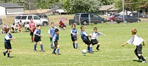 The Williams AYSO U-10 Blue Tigers fight it out on the Williams field at an earlier season game.
