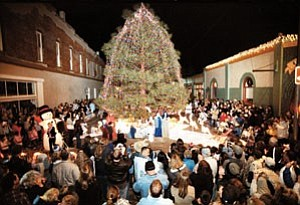 Photo/Scott Warren of Williams Color Lab Hundreds of people admire the Christmas tree as it is officially lit during the 2005 Mountain Village Holiday celebration.