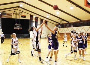 Lady Vikings player No. 12, Jenise Pettit, launches one against Sedona at an earlier December home game.